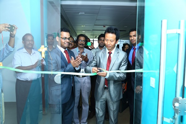 Cutting the ribbon at new office