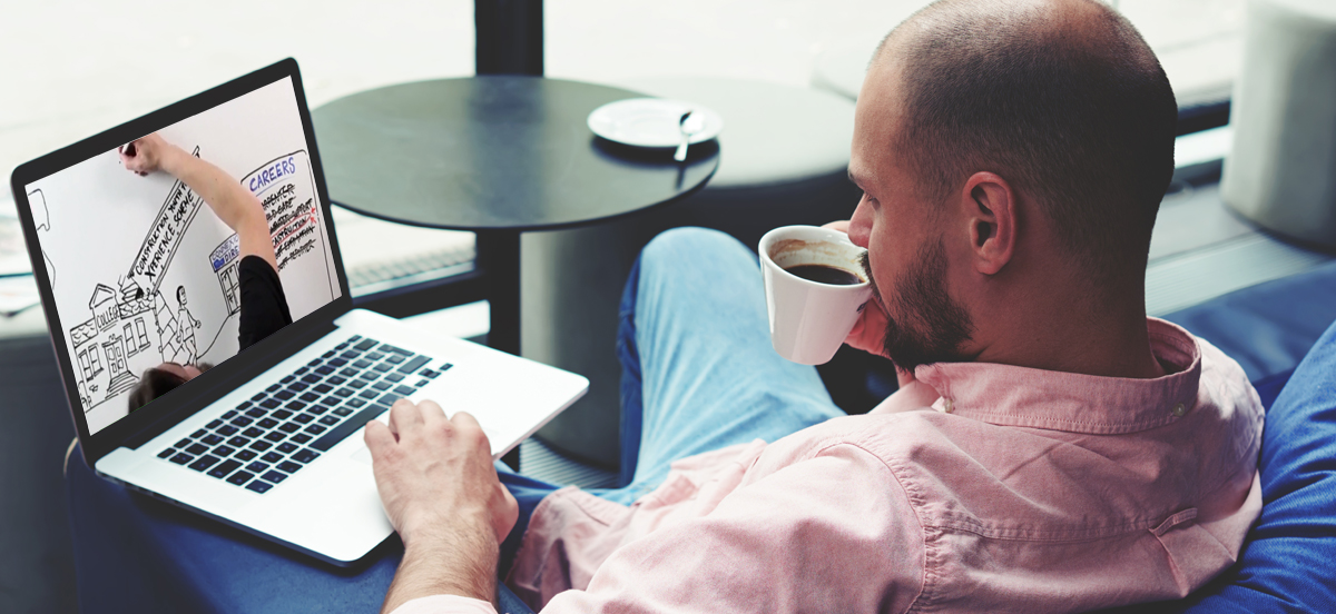 man watching bespoke content from Olive Learning on his laptop